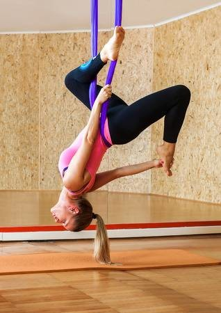 33451043-woman-doing-antigravity-aerial-yoga-young