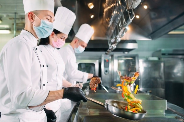 chefs-protective-masks-gloves-prepare-food-kitchen