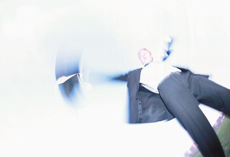 Blur of businessman throwing briefcase.jpg