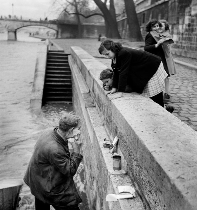 A man shaving at the dock along the Seine, Paris 1