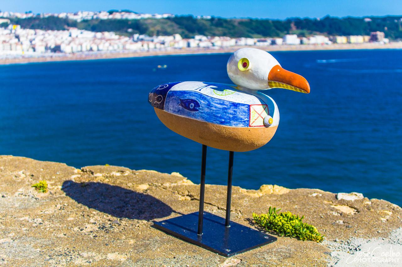 nazaré gaivota escultura farol forte mário lopes